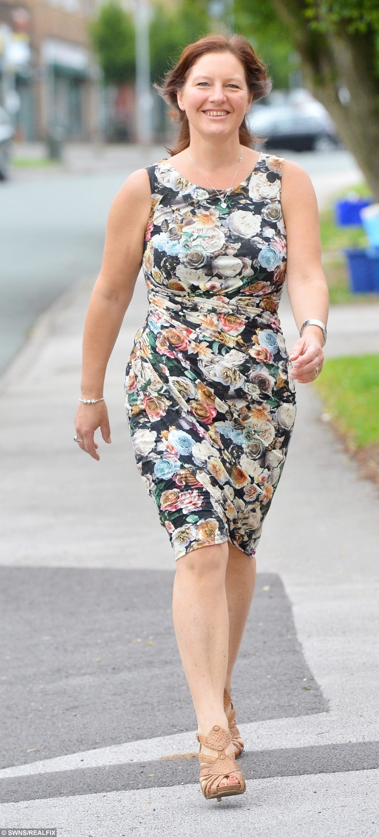 """Louise Bentley, 47, from Newcastle under Lyme, Staffs, who lost four stone in less than a year after she was horrified after seeing herself 'looking huge' in her ice bucket challenge video.  A mum-of-three lost four stone in less than a year after she was horrified when she saw herself """"looking huge"""" in her ICE BUCKET CHALLENGE video.  See NTI story NTIICE.  Louise Bentley, 47, tipped the scales at 15st 5lb last summer which was heavier than she had been even when she was nine-months pregnant.  After being made redundant from her job as a team manager at Vodafone, the mum took time off to enjoy the school holidays with her three sons.  During the summer, she was nominated by friend Adele Bossons, 46, to take part in the Ice Bucket Challenge.  The craze, which swept the nation, saw people dunking a bucket of freezing cold water over themselves to raise money for the Motor Neurone Disease Association.  Louise took part in the challenge with her husband Phil, 46, and three sons Connor, 15, Ben, 13 and nine-year-old Nat and posted it on Facebook at the end of August.  But when the mum-of-three looked back at the video she was horrified at how big she looked.  Louise joined her local Slimming World group at the start of September and has since shed an impressive four stone in nine months and now weighs a healthy 11st 4lb.  She swapped chocolate biscuits and gin and tonic for healthy meals and has gone from a frumpy size 18 to a svelte size 12."""