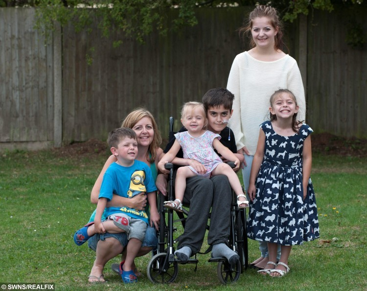 "The Fitzgerald family (from left), Kai, 5, Jackie, 41, Freya, 2, Sam Fitzgerald, 15, Amber 18 and Keira, 8.  See News Team story NTILIVER: A 15-year-old boy has been left wheelchair-bound with a life-threatening liver disease - after doctors dismissed his symptoms SIX times saying he was just a ""moody teenager."" Sam Fitzgerald was a regular teenage boy only 18 months ago and enjoyed nothing more than a game of football with his friends at school. But in March last year his mum, Jackie Courtney, 41, started to notice a change in her son who wasn't being himself and had an increasingly short temper. She took him to his GP on a monthly basis but on each occasion his problems were dismissed as ""hormones"" and ""teenage problems""."