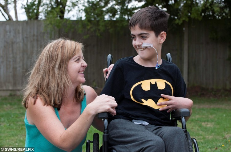 "Sam Fitzgerald, 15, pictured with his mum Jackie Courtney, 41. See News Team story NTILIVER: A 15-year-old boy has been left wheelchair-bound with a life-threatening liver disease - after doctors dismissed his symptoms SIX times saying he was just a ""moody teenager."" Sam Fitzgerald was a regular teenage boy only 18 months ago and enjoyed nothing more than a game of football with his friends at school. But in March last year his mum, Jackie Courtney, 41, started to notice a change in her son who wasn't being himself and had an increasingly short temper. She took him to his GP on a monthly basis but on each occasion his problems were dismissed as ""hormones"" and ""teenage problems""."