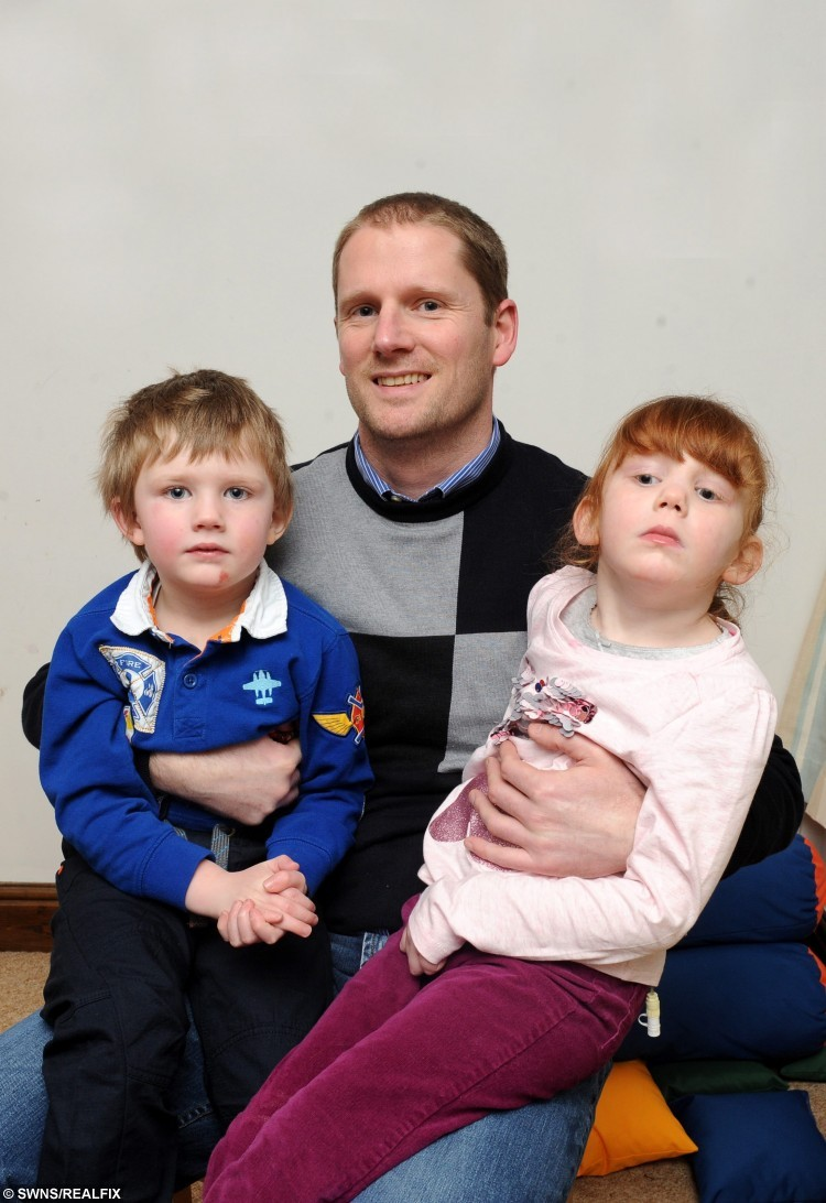 """Picture shows Caleb and Ellie Mae with their dad Duncan Brownnutt who is to ride to the Arctic Circle. See Ross Parry copy RPYARCTIC : A dad whose two children were both diagnosed with a rare incurable illness days before Christmas has set out on a 500-mile bike ride to the Arctic Circle - on a TANDEM. Duncan Brownnutt, 40, alongside family friend Rod Wark, has flown to Norway to take on a 500-mile tandem bike ride to the Arctic Circle to help raise funds for the Batten Disease Family Association (BDFA). DuncanÃs children, Ellie Mae, six and Caleb, five were both diagnosed with Late Infantile Batten Disease days before Christmas in 2013.Duncan, from Leeds, West Yorks., said: """"They were diagnosed on 20 December 2013. The doctor could tell Ellie Mae had the condition due to the results of a second MRI scan which showed her brain was shrinking."""