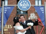 Love me do! Beatles fans give their wedding guests a mysterious Ticket to Ride