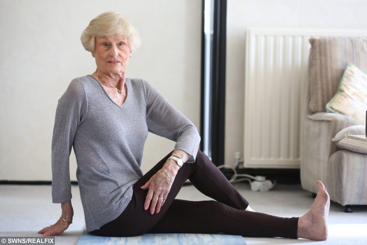 Picture Shows Betty Marshall at her home in Scarcroft, West Yorkshire. Despite being 85-years-old Betty is still practising yoga. See Ross Parry copy RPYYOGA. A great-grandmother-of-seven is still flexing away aged 85, thanks to her love of YOGA. Yoga fanatic Betty Marshall has been practising the art for more than 40 years, and says it has transformed her life, making her fitter and very flexible. Mrs Marshall has taught classes for 42 years and has even used it help people with multiple sclerosis and stroke victims. Ian Hinchliffe / Rossparry.co.uk