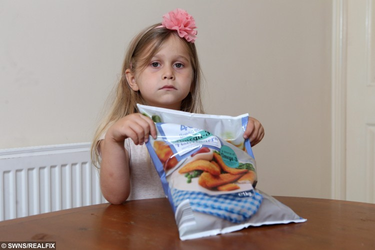 Ellie-Jay Young, 6, with some fish fingers bought from Iceland, pictured at her home in Pontefract, West Yorkshire, on 25 August 2015. Earlier this year Robert Young was shocked when he found a piece of cardboard in some fish fingers he had bought, from Iceland, for his daughter Ellie-Jay.  See Ross Parry Copy. RPYFISHFINGER: A man has vowed never to eat fish again after his daughter almost choked to death on a piece of cardboard he found inside a FISH FINGER. Robert Young, 26, said he had just served up Ellie-Jay, six, a teatime favourite of Iceland own brand fish fingers, chips and beans, when the youngster began to choke. Robert said: ÃI had just made Ellie-Jay her tea and made a fish finger sandwich for myself when she began choking. ÃShe just panicked, this piece of cardboard was stuck in her throat. I had to put my fingers down her throat and pull the cardboard out.
