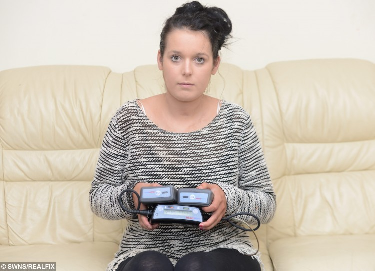 "Louise Grimshaw from Leigh, Lancs., with her heart pacer machine, 27 August 2015. See Ross Parry Copy RPYHEART : A young mum turned BLACK after her GP failed to spot a life-threatening illness which could kill her by the age of 30. The family of Louise Grimshaw, 20, say a doctor failed to spot signs of the rare Addison's Disease, despite her father having to carry her into the surgery as she couldn't walk. Her family was told to ""take her home and feed her up"" but now say she has as little as nine years left to live and an urgent heart transplant is her only chance of survival. The GP has been rapped by the General Medical Council who said he failed to carry out an adequate examination."