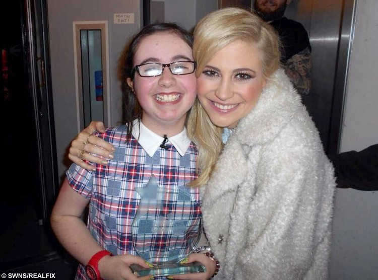 Neve Johnstone with Pixie Lott. See Centre Press story CPSELFIE; A little girl with a rare bone disease has made it her mission to meet as many celebrities as possible to raise money for charity. Neve Johnston, 12, from Falkirk, was born with Osteogenesis Imperfecta, a disease which causes a personÃs bones to become brittle and prone to breaking. But for the last few years, Neve has been raising money for Hearts and Minds, by getting selfies with celebrities. Hearts and Minds is charity group of clown doctors who treat and entertain young patients, and Neve has had her photograph has already managed to get 15 celebrities in the bag.