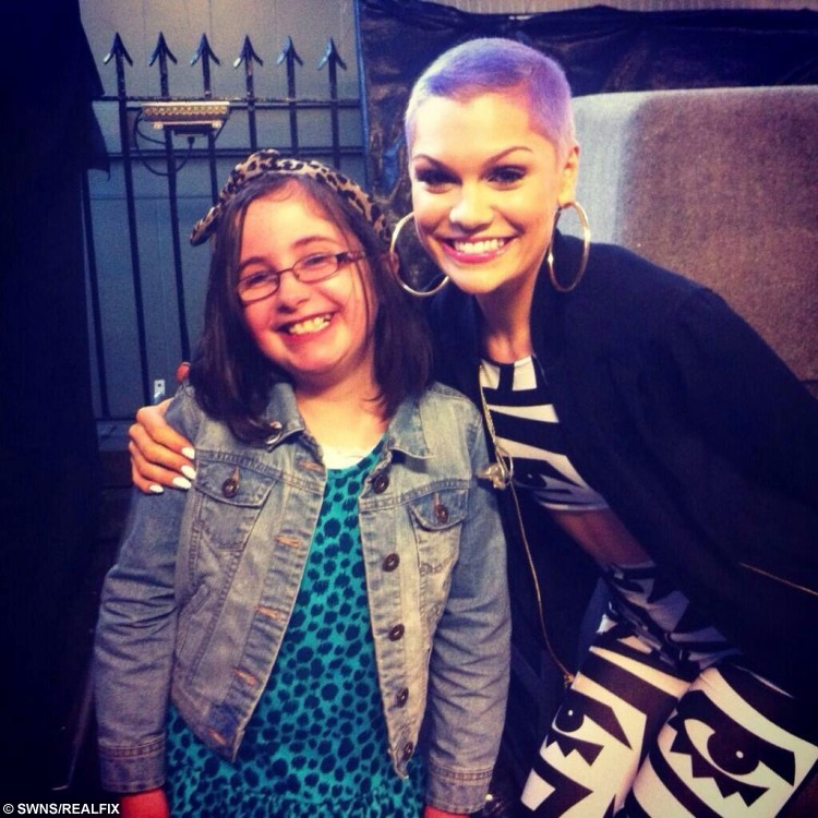 Neve Johnstone with singer Jessie J. See Centre Press story CPSELFIE; A little girl with a rare bone disease has made it her mission to meet as many celebrities as possible to raise money for charity. Neve Johnston, 12, from Falkirk, was born with Osteogenesis Imperfecta, a disease which causes a personÃs bones to become brittle and prone to breaking. But for the last few years, Neve has been raising money for Hearts and Minds, by getting selfies with celebrities. Hearts and Minds is charity group of clown doctors who treat and entertain young patients, and Neve has had her photograph has already managed to get 15 celebrities in the bag.