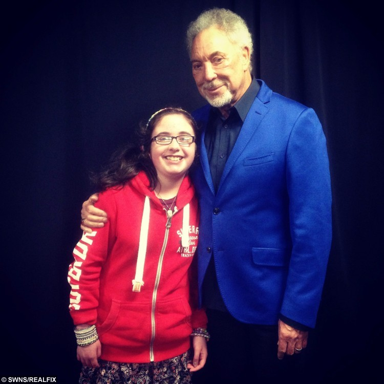 Neve Johnstone with Tom Jones. See Centre Press story CPSELFIE; A little girl with a rare bone disease has made it her mission to meet as many celebrities as possible to raise money for charity. Neve Johnston, 12, from Falkirk, was born with Osteogenesis Imperfecta, a disease which causes a personÃs bones to become brittle and prone to breaking. But for the last few years, Neve has been raising money for Hearts and Minds, by getting selfies with celebrities. Hearts and Minds is charity group of clown doctors who treat and entertain young patients, and Neve has had her photograph has already managed to get 15 celebrities in the bag.