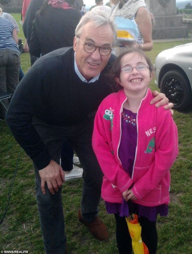 Neve Johnstone with Larry Lamb. See Centre Press story CPSELFIE; A little girl with a rare bone disease has made it her mission to meet as many celebrities as possible to raise money for charity. Neve Johnston, 12, from Falkirk, was born with Osteogenesis Imperfecta, a disease which causes a personÃs bones to become brittle and prone to breaking. But for the last few years, Neve has been raising money for Hearts and Minds, by getting selfies with celebrities. Hearts and Minds is charity group of clown doctors who treat and entertain young patients, and Neve has had her photograph has already managed to get 15 celebrities in the bag.