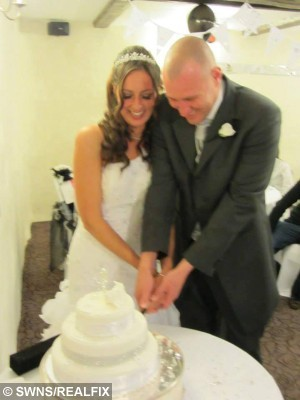 """Collect picture. Ellie, 34, (left) and husband Daniel, 33, (right) Baker on their wedding in Plymouth, England. May 25 2013. Ellie suffered alopecia in the run up to their wedding. A bride-to-be has revealed she suffered so much stress planning her wedding she went BALD just before her big day. See SWNS story SWHAIR;  Hairdresser Ellie Baker, 35, was devastated when she lost her own locks and had to walk down the aisle in specially designed extensions after suffering alopecia. She had been busy planning the ceremony when the stress of organising the event contributed to her hair beginning to fall out. Ellie said she was terrified of being a bald bride and """"freaked out"""" when she discovered great clumps of her hair starting to fall out when she got out the shower."""