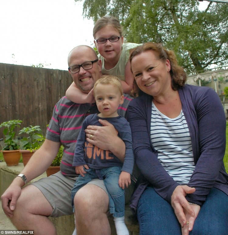Millie Vaughan from Crawley with dad, Paul, Mum, Emma, and brother Jackson.  Britain's toughest schoolgirl who has battled against a brain tumour since birth is now recovering from having both her feet broken - because chemotherapy buckled her LEGS.  See SWNS story SWTOUGH; Nine-year-old Milly Vaughan has been fighting cancer since birth, but not even having both legs in plaster has stopped the schoolgirl from smiling.  The courageous youngster was born with a cancerous tumour on her brain, which doctors have been unable to remove due to its dangerous  position.  Chemotherapy she underwent as a baby caused her to legs to become misshapen due to nerve damage, which caused her agony while walking as her feet were turning out. Milly, from Crawley, West Sussex, has spent the last seven weeks with her legs in plaster - and faces a further two months in leg splints - after medics broke bones in both her feet in a bid to correct her stride.  Milly's mum Emma, 36, says her daughter is remaining typically positive about not being able to take part in some things at school.