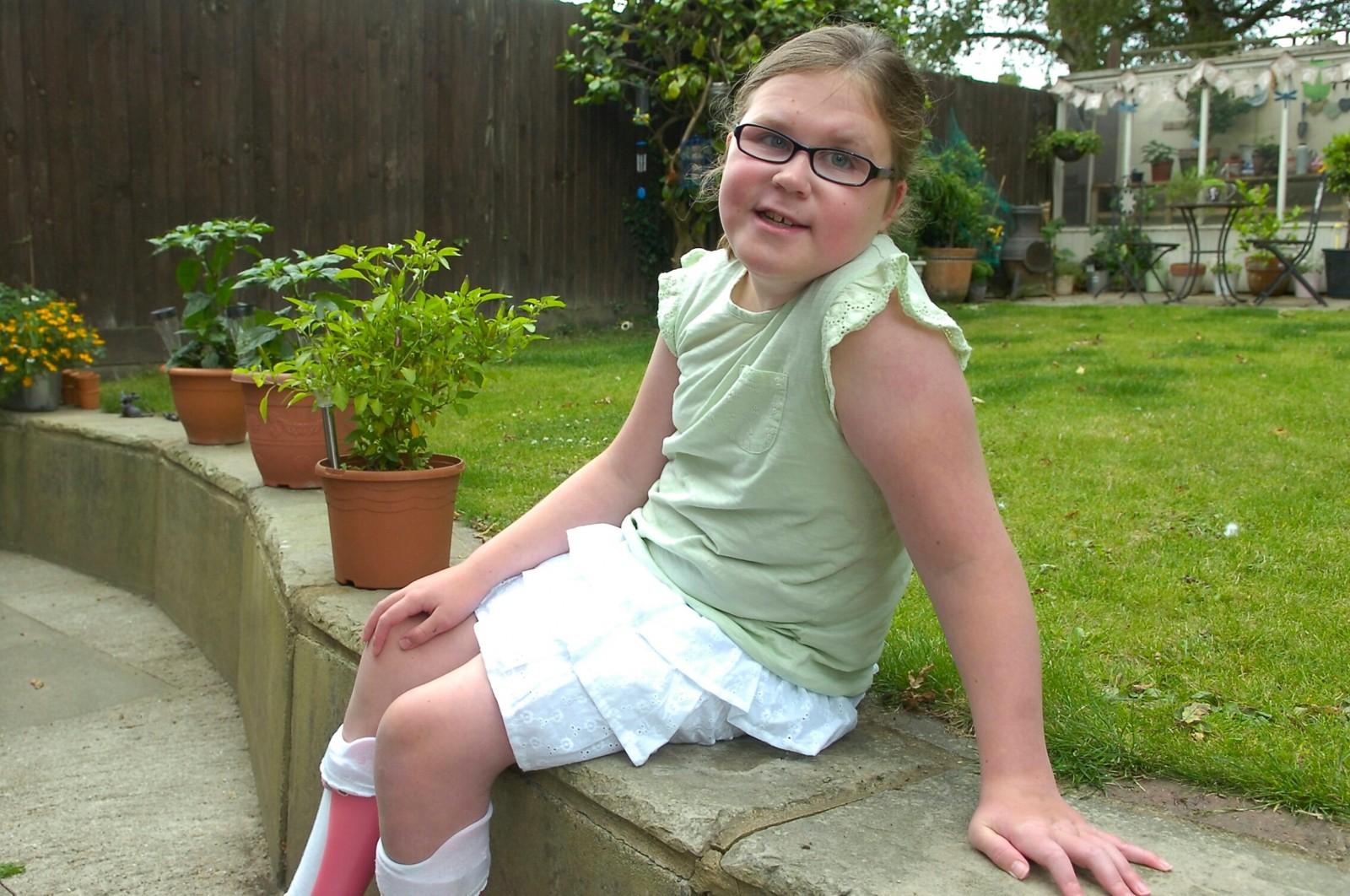 Brave schoolgirl born with brain tumour has feet deliberately broken by doctors