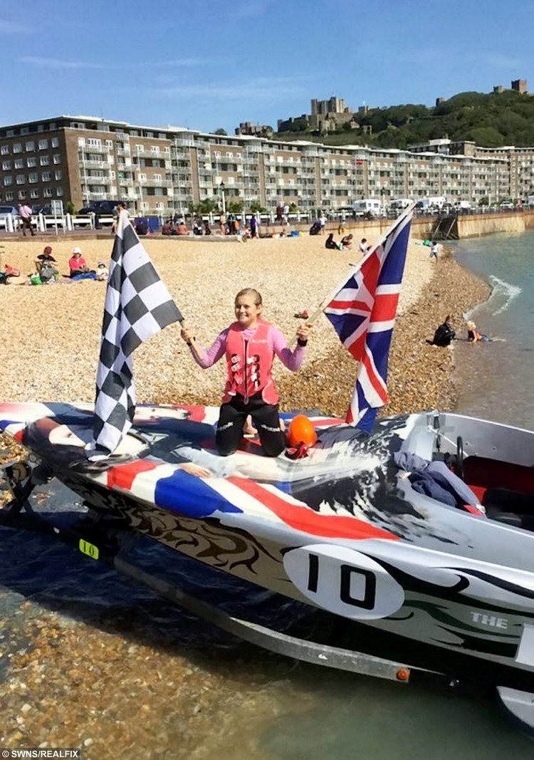 """Lauren Bird back in Dover.  A 13 year-old school girl from Burnham-on-Sea, Somerset became to the youngest person to water ski across the English Channel on Saturday 29 August 2015.  See SWNS story SWSKI.  Lauren Bird attempted the crossing from France ([just off the Cap Gris-Nez - near the village of Framezelle) to England at 6am in the morning and encountered choppy conditions, described by crew as """"boat breaking"""", that caused her bindings to break in a fall at the 10 miles mark. She returned to shore with her team, repaired the ski and refuelled and attempted the crossing again at 10:35am.  Lauren successfully completed the crossing in 54:06 minutes and was elated with her achievement."""