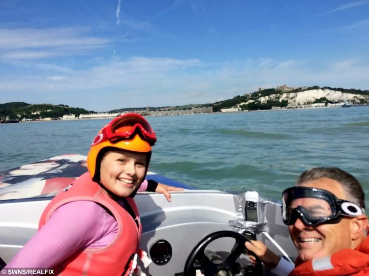 """Lauren Bird with Steve Cox returning to shore.  A 13 year-old school girl from Burnham-on-Sea, Somerset became to the youngest person to water ski across the English Channel on Saturday 29 August 2015.  See SWNS story SWSKI.  Lauren Bird attempted the crossing from France ([just off the Cap Gris-Nez - near the village of Framezelle) to England at 6am in the morning and encountered choppy conditions, described by crew as """"boat breaking"""", that caused her bindings to break in a fall at the 10 miles mark. She returned to shore with her team, repaired the ski and refuelled and attempted the crossing again at 10:35am.  Lauren successfully completed the crossing in 54:06 minutes and was elated with her achievement."""
