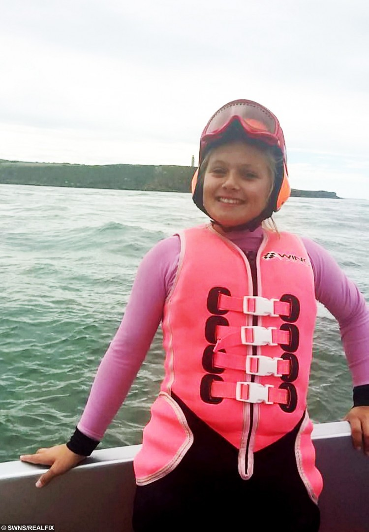"""Lauren Bird getting ready to start the crossing.  A 13 year-old school girl from Burnham-on-Sea, Somerset became to the youngest person to water ski across the English Channel on Saturday 29 August 2015.  See SWNS story SWSKI.  Lauren Bird attempted the crossing from France ([just off the Cap Gris-Nez - near the village of Framezelle) to England at 6am in the morning and encountered choppy conditions, described by crew as """"boat breaking"""", that caused her bindings to break in a fall at the 10 miles mark. She returned to shore with her team, repaired the ski and refuelled and attempted the crossing again at 10:35am.  Lauren successfully completed the crossing in 54:06 minutes and was elated with her achievement."""