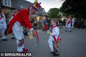 Harrison dances outside The Kings Head pub in Bledington,  Gloucestershire