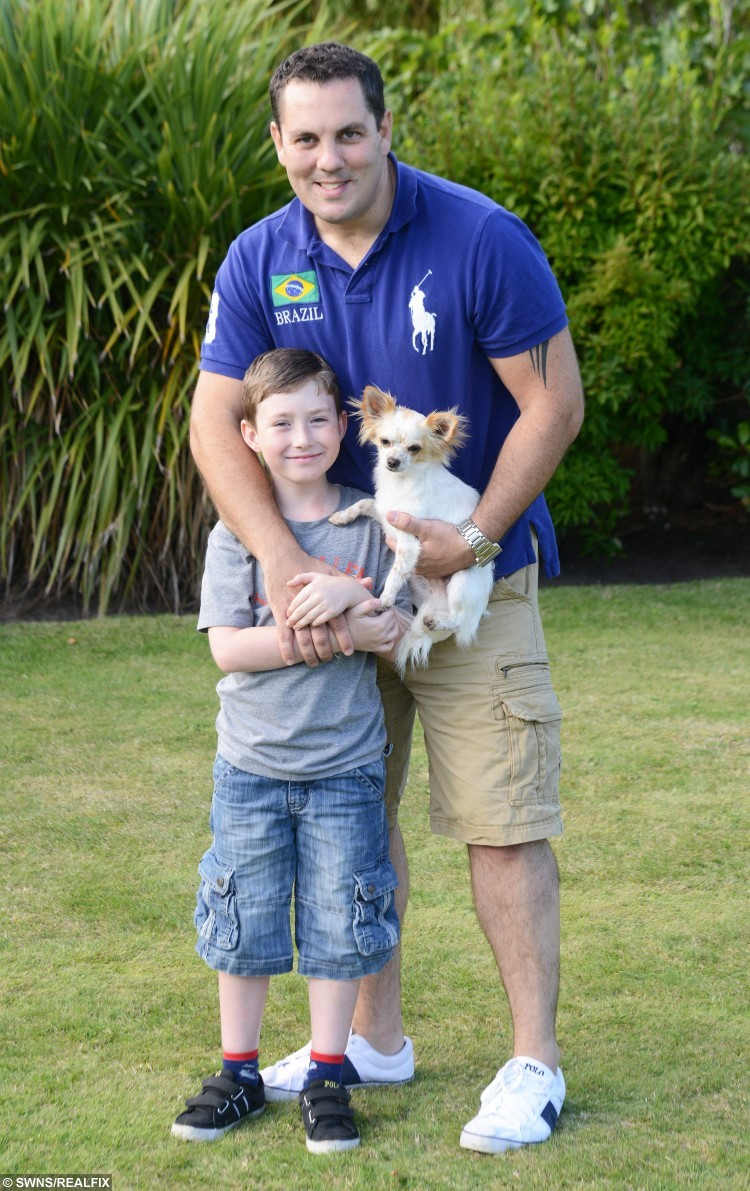 Bobo the dog with Tommy Jones and his dad Mike Jones. See SWNS story SWCUTE: A disabled boy and his lame puppy are a real pair of superheroes à after they helped each other learn how to WALK. Doctors feared little Tommy Jones, eight, would never be able to walk, after a birth complications left him semi-paralysed. So when his parents Kerry and Mike Jones heard about a Chihuahua puppy who had a badly broken leg, they decided that nurturing the little pup à named Bobo à may help their son deal with his own infirmity. Tommy, who was five at the time, and Bobo soon became best of friends, and miraculously, within weeks of meeting, they both started walking.