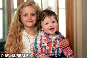 Fergus with his full head of hair and his 5 year old sister Ella