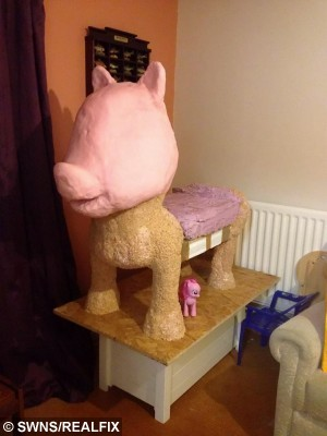 The pink pony cake during its construction