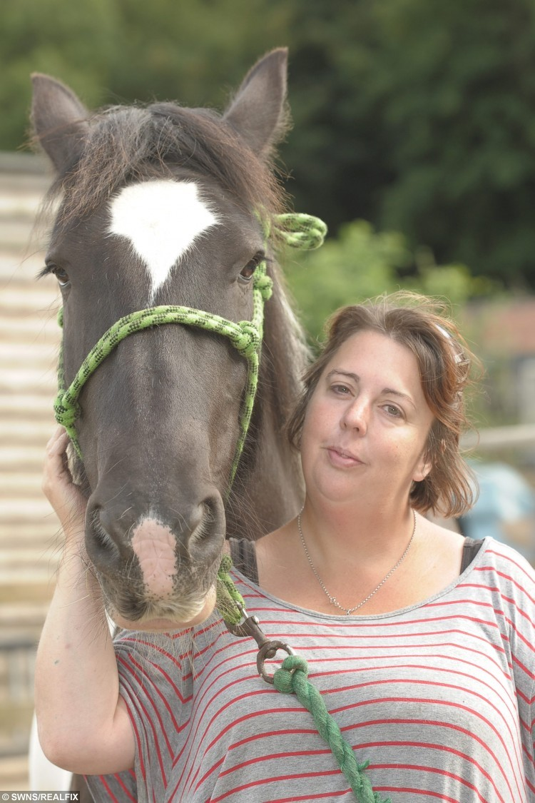 "Angie Fuller from Plymouth, Devon, with her pet horse Moomin. See SWNS story SWHORSE; A woman has won a pet look-a-like competition - for looking like her HORSE. Angie Fuller, 41, entered a contest for owners who resembled their animals. She didn't expect to win but has scooped first prize for resembling her horse Moomin. Angie, of Plymouth, Devon, said: ''I'm not really into having my picture taken. ""But we sent one in on behalf of the Ponderosa Pony Rescue Centre where Moomin is based."