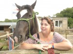 Animal lover wins competition for looking like her horse!