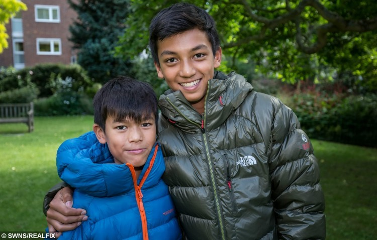 Seven year old Zain Ackrim (left), and his older brother Rehan who recently returned from a family holiday climbing Mt Kilimanjaro in Tanzania, which makes Zain the youngest ever Briton to reach the summit. See SWNS story SWCLIMB; A nine-year-old boy has become the youngest Brit ever to scale - mount KILIMANJARO. Intrepid Zain Ackrim hiked to the top  in over six days, crossing the finish line at 11.15am on August 8. It makes him the youngest Britain to climb Africa's highest peak in Tanzania with his 12-year-old brother, Rehan, and ten other people. Zain, from Holland Park, London, spent months preparing for the epic 5,895m climb which he made in just six days following a 12 hour final ascent.