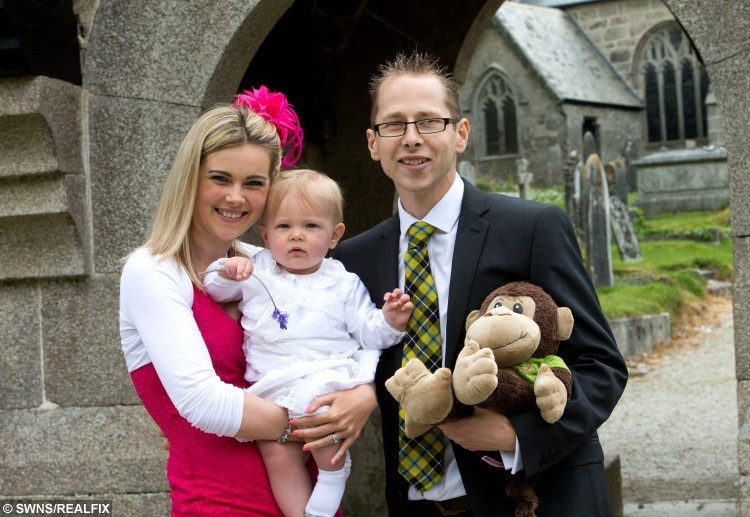 COLLECT - Lee Hall, 26, with wife Danyelle, 23, and son Hayden, 1, during the youngsters christening on May 17, 2015 and prior to Lee' heart surgery.  A young dad told yesterday (Sun) how his life was saved when he received a donor's heart - which doctors kept beating by keeping the organ in a BOX.  See SWNS story SWHEART.  Lee Hall, 26, was diagnosed with heart failure aged 14 and had a mechanical pump fitted five years ago to keep the blood flowing around his body.  But when the pump cables got infected in May this year, doctors told him he needed a new heart and said he had just TWO DAYS to find one.  He was told that, if a suitable donor could not be found that weekend, he would have to go through the trauma of having another pump fitted in the meantime.  But miraculously, an opportunity arose when the heart of a patient who had died that day was offered to Lee - and he was told it could be kept beating OUTSIDE the donor's body.  The new 'heart in a box' method can revive hearts which have been dead for up to 30 minutes - and keep them alive for up to EIGHT HOURS before an operation.  It could save hundreds of lives as it DOUBLES the amount of time that hearts can be preserved outside of the body.