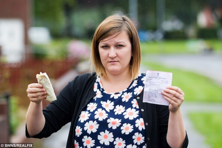 Emma Lawrence who got fined ÃÃ75 by the council for throwing a  small piece of lettuce (from a McDonalds chicken wrap) out of her window. Cwmbran, Wales. 25 August 2015.   See SWNS story SWLETTUCE: A mum couldn't be-leaf it when she was slapped with a Ã75 fine - for dropping a small piece of lettuce from her McDonald's wrap. Emma Lawrence, 22, was issued with an on-the-spot fine by a council worker who accused her of throwing a receipt from her car window as she left a drive-through. She explained that she had not received a receipt but had flicked a small piece of lettuce out of the window after it fell onto her leg. Despite the leaf being smaller than the tip of her finger and biodegradable, Emma was told the Ã75 fine for littering still stood.