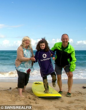 Little Madison with her adoptive parents Margaret, 57, and Ted Eddy, 58. A severely disabled young girl has stunned her family by walking for the first time at the age of eight à after taking up SURFING. See swns story SWSURF. Little Madison Eddy was born three months premature and had spent her entire life in a wheelchair suffering from cerebral palsy and epilepsy. But she has now been hailed a medical miracle by taking her first steps shortly after completing a six week surfing course with charity the Wave Project.And her proud adoptive parents Margaret, 57, and Ted Eddy, 58, claim it only happened because of her increased confidence gained out at sea. Madison, from Redruth, Cornwall, was severely disabled from birth with a bleed on her brain after being born at just 23 weeks. She could not breathe on her own, and could only be fed through a tube. Doctors had to perform an emergency tracheotomy to enable her to breathe, and she required further surgery later to repair her trachea. She spent her first 18 months in hospital, before being fostered and later adopted by Mr and Mrs Eddy.