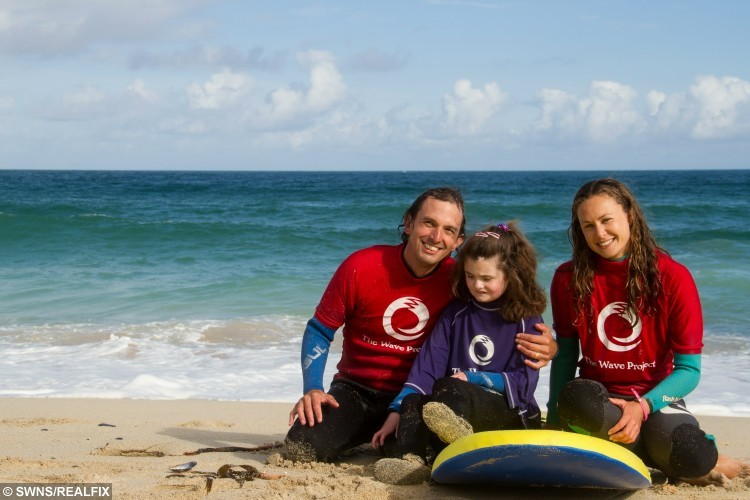 Little Madison Eddy with Joe Taylor and Katy Spencer staff from the Wave project. A severely disabled young girl has stunned her family by walking for the first time at the age of eight à after taking up SURFING. See swns story SWSURF. Little Madison Eddy was born three months premature and had spent her entire life in a wheelchair suffering from cerebral palsy and epilepsy. But she has now been hailed a medical miracle by taking her first steps shortly after completing a six week surfing course with charity the Wave Project.And her proud adoptive parents Margaret, 57, and Ted Eddy, 58, claim it only happened because of her increased confidence gained out at sea. Madison, from Redruth, Cornwall, was severely disabled from birth with a bleed on her brain after being born at just 23 weeks. She could not breathe on her own, and could only be fed through a tube. Doctors had to perform an emergency tracheotomy to enable her to breathe, and she required further surgery later to repair her trachea. She spent her first 18 months in hospital, before being fostered and later adopted by Mr and Mrs Eddy.