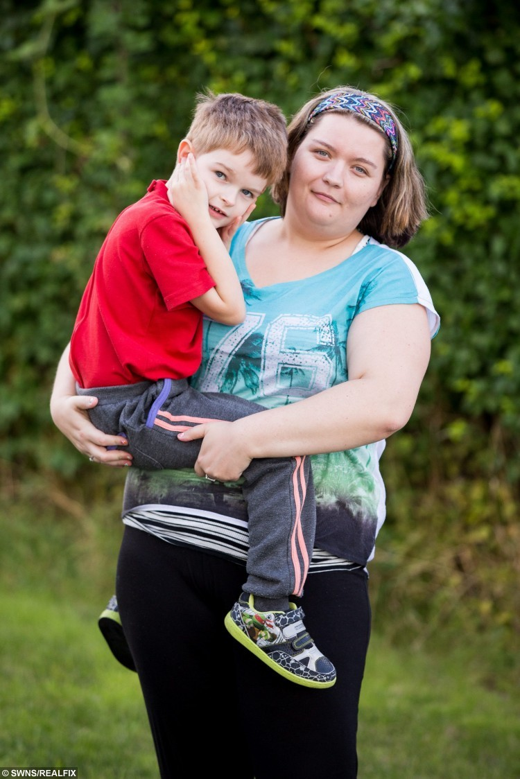 Zoe Burlton and her son Harry, 6, who eats mattresses, carpets and wallpaper.  Little Harry Burlton is quite literally eating his mother out of house and home - by munching his way through carpets, wallpaper and even his BED.  See SWNS story SWCARPET.  Zoe Burlton, 24, has been forced to buy new flooring for her living room because Harry, six, has an obsession with tearing things into little pieces and eating them.  The autistic youngster rips wallpaper down, peels paint from the walls and pulls mattresses apart.   Now his mum is fundraising to build him a 'safespace' with soft surfaces that so tough he cannot tear them up.