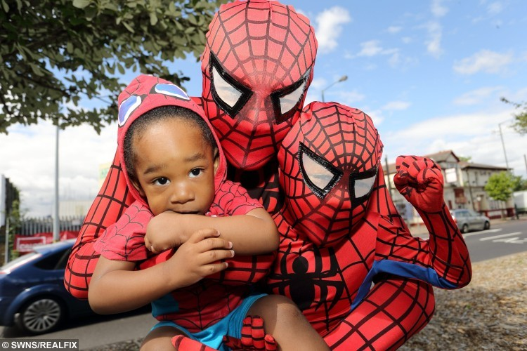 Spiderman Dad as he is known Christopher Lee and his son Christopher Lee jnr 4, and Xiong 1 pose together at the Thornton Heath Pond. This is the inspiring dad who dresses up as Spider-Man every day - all for the love of his children. See SWNS story SWHERO;  Christopher Lee, 40, caused a stir last week after he was spotted in a supermarket with his two sons all dressed as the world-famous superhero. The father-of-two from Thorton Heath, south London, said that he began wearing the outfit for his super-hero obsessed sons Christopher Junior, four, and 16-month-old Xiong (corr). The photographer explained that his four-year-old, Christopher Jr, adores the character and was ecstatic when he first saw his dad dressed up. He said: ÃWhen he's not watching the cartoon, he's singing 'Spider-Man, Spider-Man'.