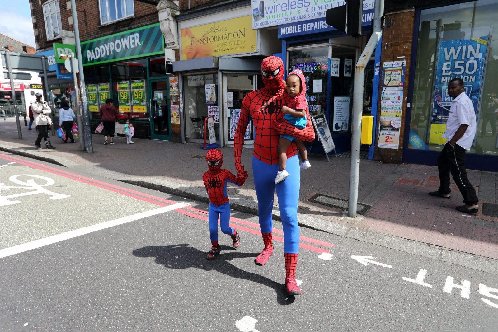 It's Spider-Dad! Devoted father does chores dressed as superhero – simply to make his sons happy