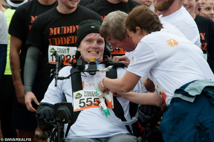 Rob Camm takes part in the Tough Mudder event at Cirencester Park, Cirencester, England. August 23 2015. Camm is the first tetraplegic in the world to take part in a Tough Mudder event which he navigated using a special wheelchair controlled by his chin and accompanied by a team of friends and family.  See SWNS story SWROBO; A student has become the world's first tetraplegic to take part in Tough Mudder - navigating the gruelling 12-mile course in a pioneering wheelchair he controls with his CHIN. Rob Camm, 21, was paralysed in a car crash two years ago which left him with no movement in his body from the neck down just a week before he was due to start university. Last month, he became the first tetraplegic in the world who is reliant on a ventilator to learn how to walk again using a robotic skeleton controlled by his THOUGHTS. Now, he has taken part in the notorious Tough Mudder challenge - dubbed 'probably the toughest event on the planet' - in an off-road wheelchair set on top of a QUAD BIKE.