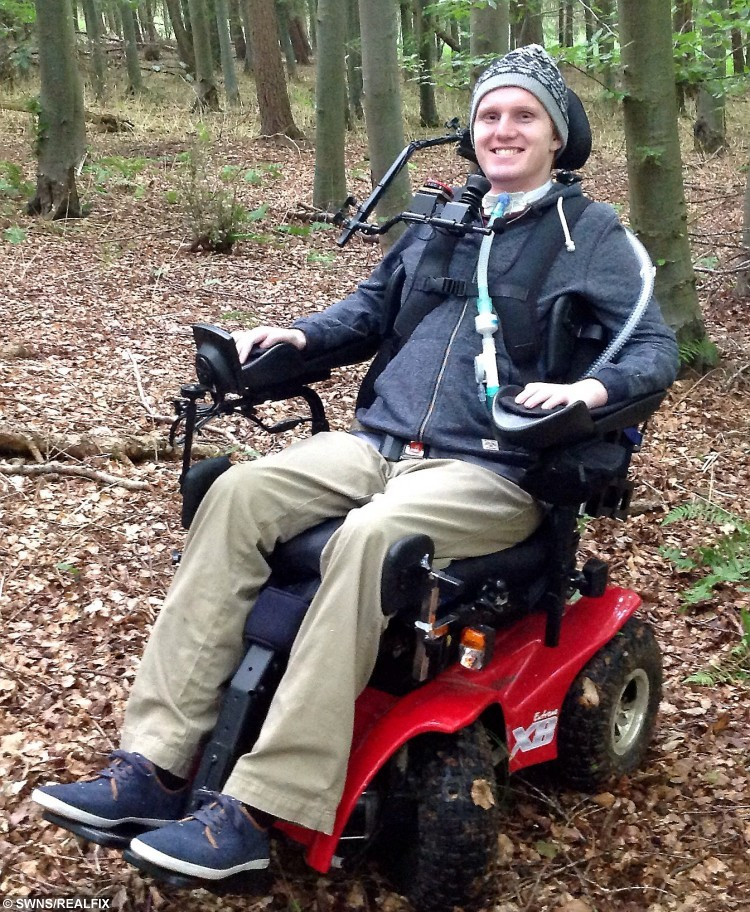 Tetraplegic Rob Camm who is set to take part in a Tough Mudder assault course. See SWNS story SWROBO; A student will be the world's first tetraplegic to take part in Tough Mudder - navigating the gruelling 12-mile course in a pioneering wheelchair he controls with his CHIN. Rob Camm, 21, was paralysed in a car crash two years ago which left him with no movement in his body from the neck down just a week before he was due to start university. Last month, he became the first tetraplegic in the world who is reliant on a ventilator to learn how to walk again using a robotic skeleton controlled by his THOUGHTS. Now, he will take part in the notorious Tough Mudder challenge - dubbed 'probably the toughest event on the planet' - in an off-road wheelchair set on top of a QUAD BIKE.