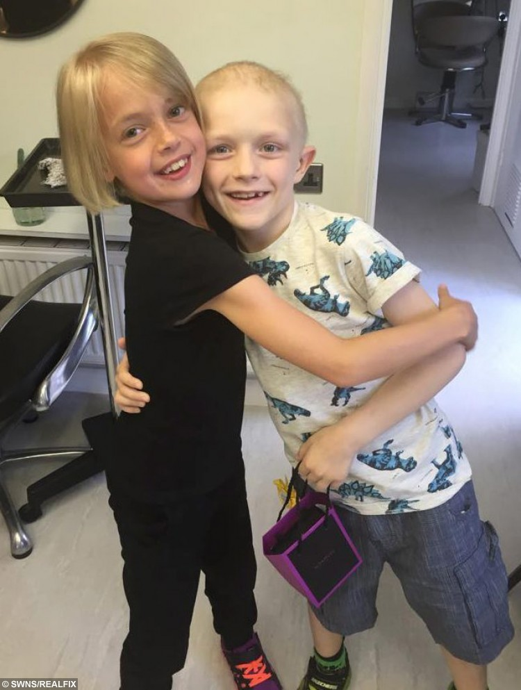 Libby Tucker(L) who cut her long hair for cancer sufferer Aiden Selleck(R). See MASONS story MNHAIR; A Iovestruck nine-year-old who dreams of being Rapunzel is cutting off all her hair to help her boyfriend survive cancer. Little Libby Tucker-Spiers and Aiden Selleck are inseparable and have told their families they will one day marry. Libby, who has global developmental delay and a growth problem, was devastated when seven-year-old Aiden was diagnosed with a rare kidney cancer.