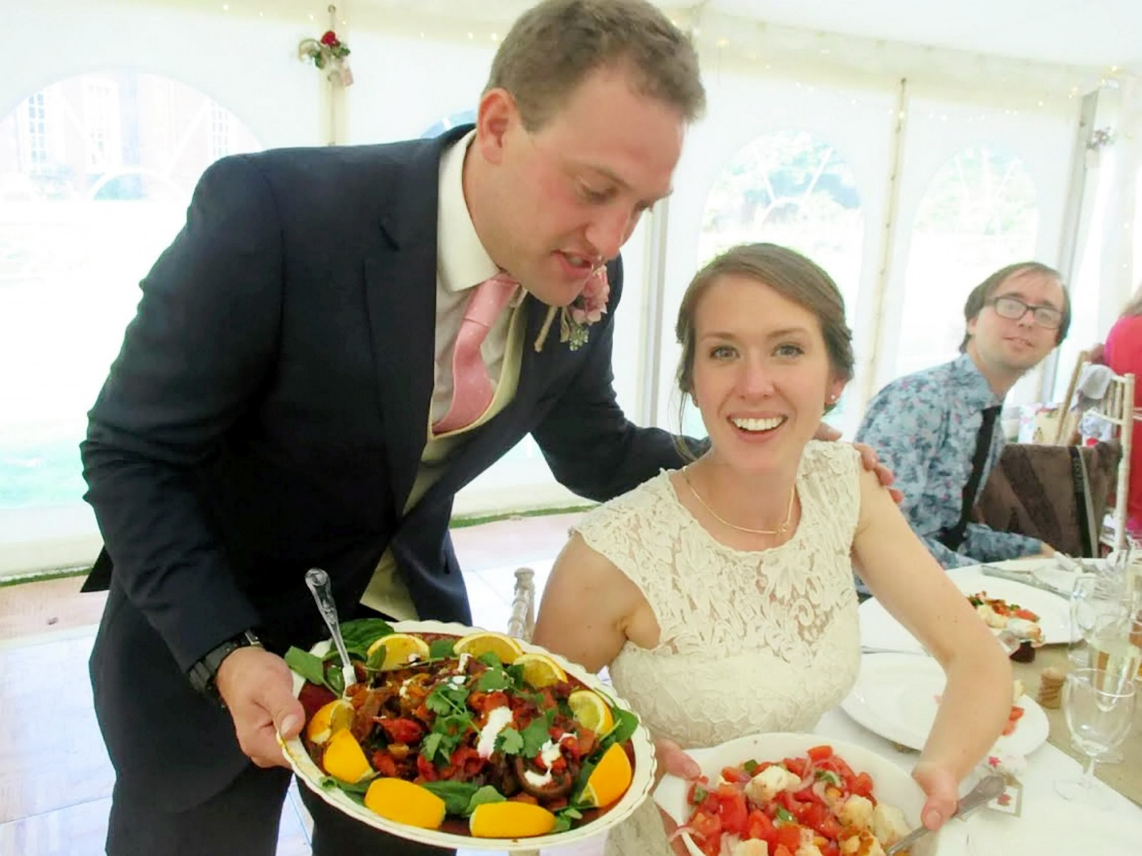 Bride and groom serve their wedding guests a meal destined for the BIN