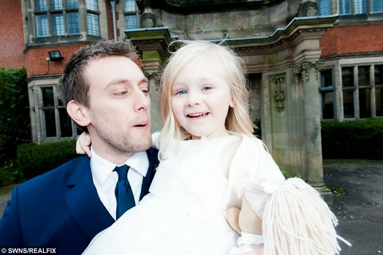 FILE PICTURE - Collect photo of  Tom Attwater with his daughter Kelli at his wedding in April 2014.  A devoted dad who raised more than Ã500,000 to ensure his six-year-old girl receives lifesaving cancer treatment has died after battling a brain tumour for three years.  See NTI story NTICANCER.  Tragic Tom Attwater, 32, captured the hearts of the nation by fighting his own ill health to ensure his stepdaughter Kelli Smith would receive pioneering medical care she needs and NHS do not fund.  The youngster endured childhood cancer neuroblastoma aged just three months and again aged three.  And despite battling his own cancer, astrocytoma, since September 2012, brave Tom determinedly raised the cash for his child to live a long life and have treatment in USA if she has a relapse.  But on Tuesday (29/9) Tom died at his home in Pattingham, Staffs., with his family by his side.  The businessman is survived by widow Joely, 28, Kelli and his five-month-old son Fletcher.