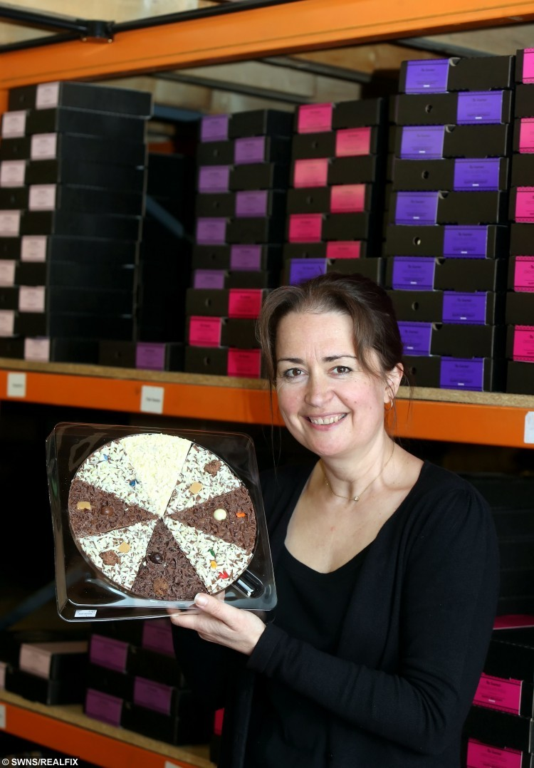 "Sweet-toothed Helen Ellis is tasting sweet success from her business - making luxury chocolates in the shape of PIZZAS.The 46-year-old mum started making treats for her two children in her kitchen at home before ditching her admin job to concentrate on the venture full-time.See NTI story NTIPIZZA. She now runs Gourmet Chocolate Pizza Company and turns over a mouth-watering Ã700,000-a-year selling the snacks around the world..Mrs Ellis, from Nottingham, said: ""It was something different and that wasn't already out there. I very quickly dropped everything else to focus on the pizzas.""We started with around six flavours of chocolate pizzas. Now we have 13 and we extended the range last year, when we also introduced Christmas gifts."""