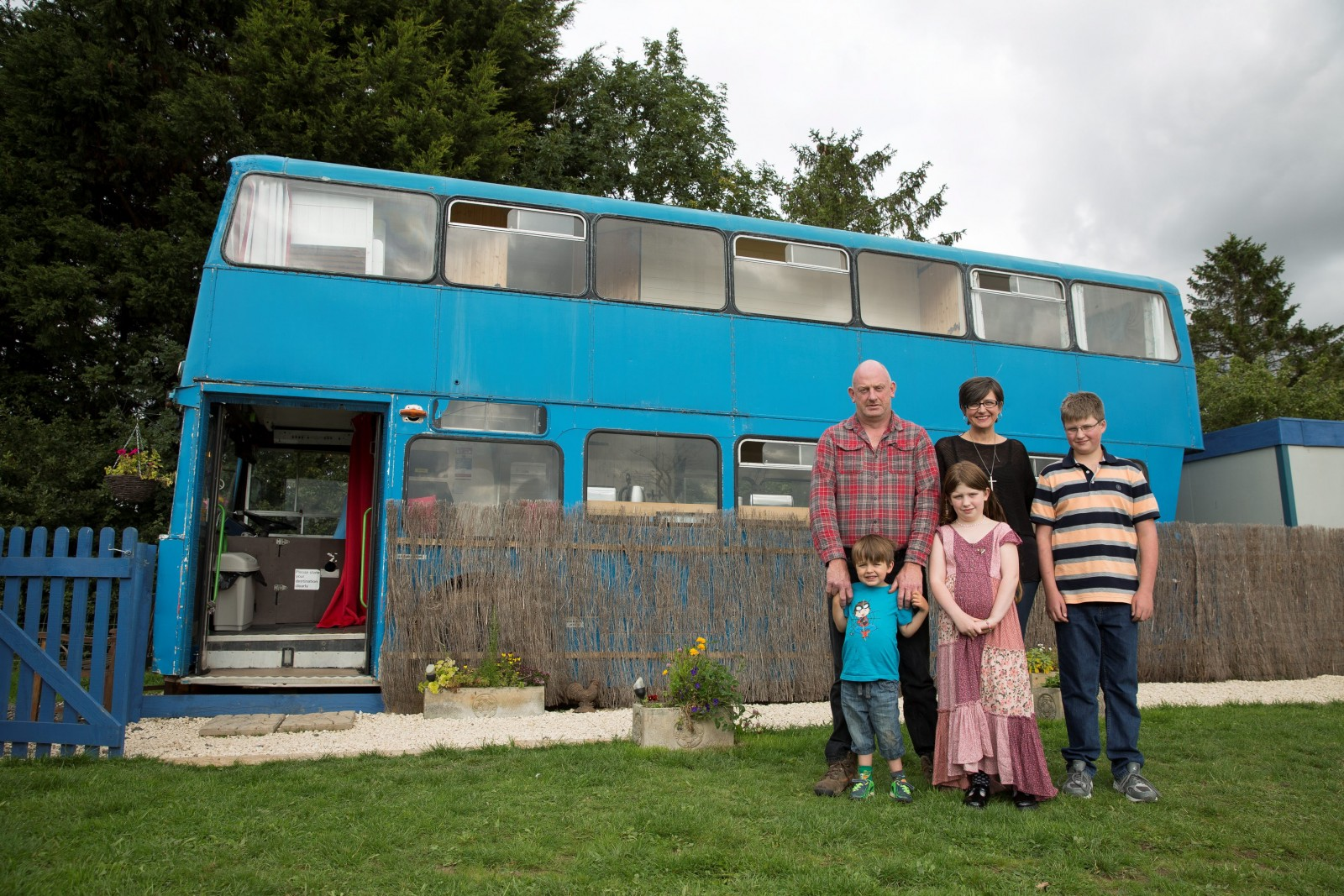 Family convert double-decker into dream holiday home because they didn't fit in a caravan