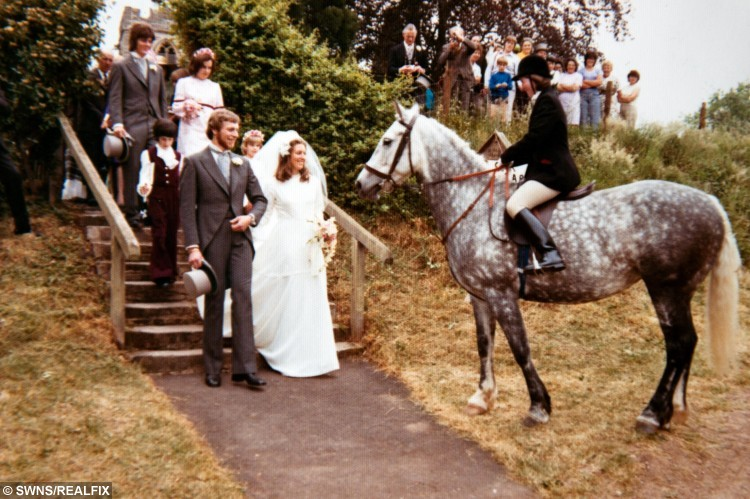 Christopher and Anna Richards who were also visited by a horse on their wedding day in 1975.   A very special guest was on the wedding list for one Worcester bride.  See NTI story NTIHORSE.  Caroline Dunnell's much-loved horse Pip came to the churchyard at St John the Baptist church in Crowle to pose for pictures just after a ceremony in which she married Steven Dunnell.  The gelding even brought a gift of a good luck horseshoe - one of his own naturally - engraved with the names of the happy couple.  The visit has become part of an unusual wedding tradition for the bride's family as her parents Christopher and Anna Richards were also visited on their wedding day in 1975 by Mrs Richards's horse Candy.  Candy also brought a good luck horseshoe.