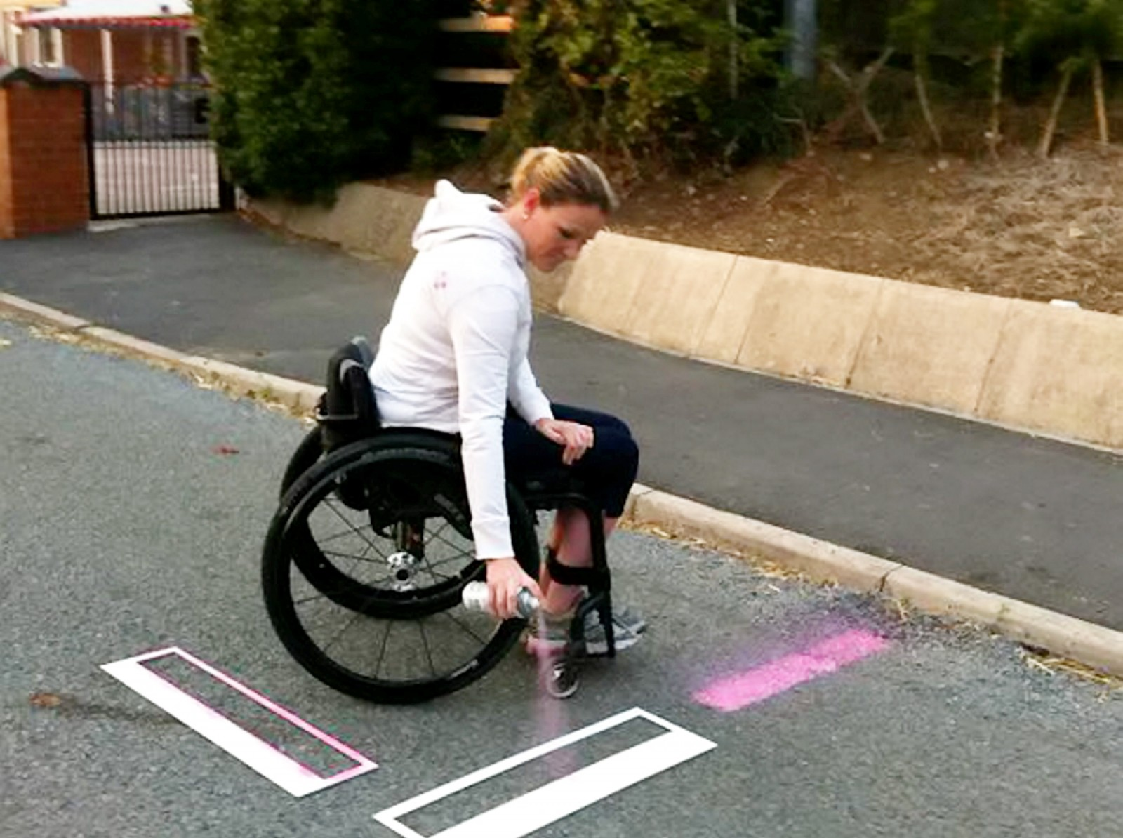 Paralysed mum sick of waiting for disabled parking outside daughter's school gets out the spray can