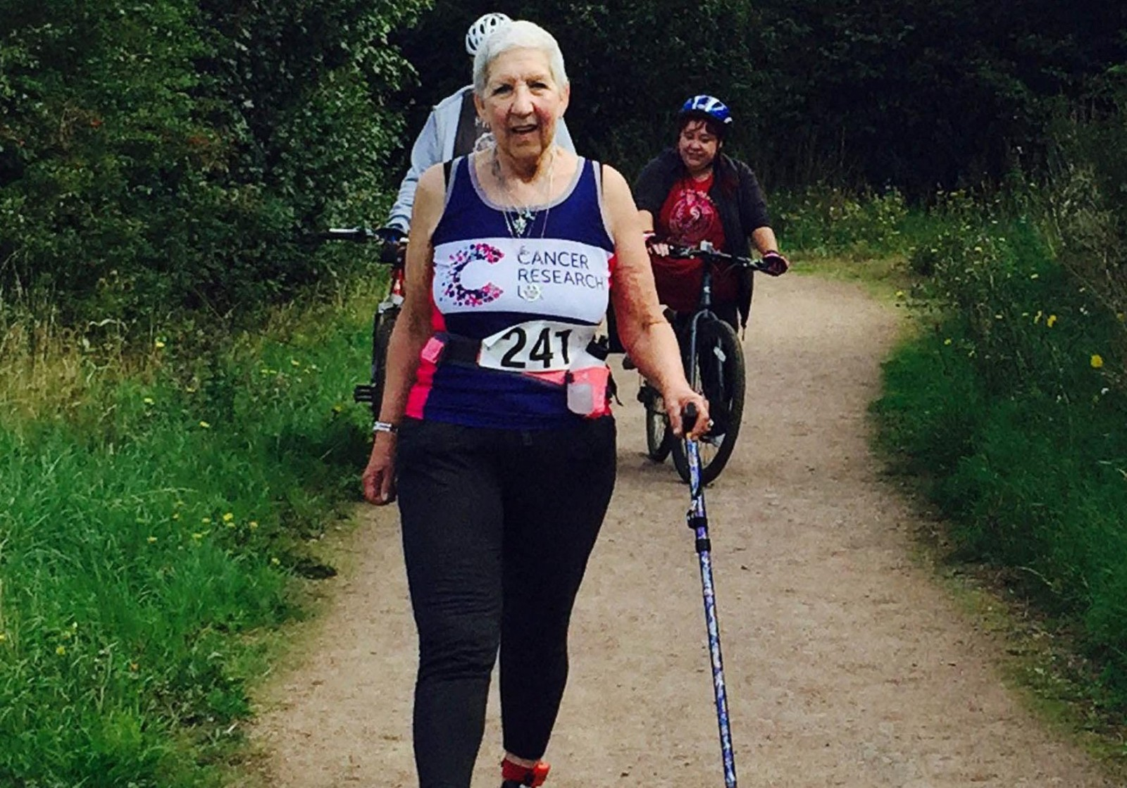 Gran diagnosed with FIVE types of cancer in TWO years defies odds to complete 10K walk