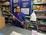 Hero gran fights off armed robbers with a STICK during terrifying raid on her shop