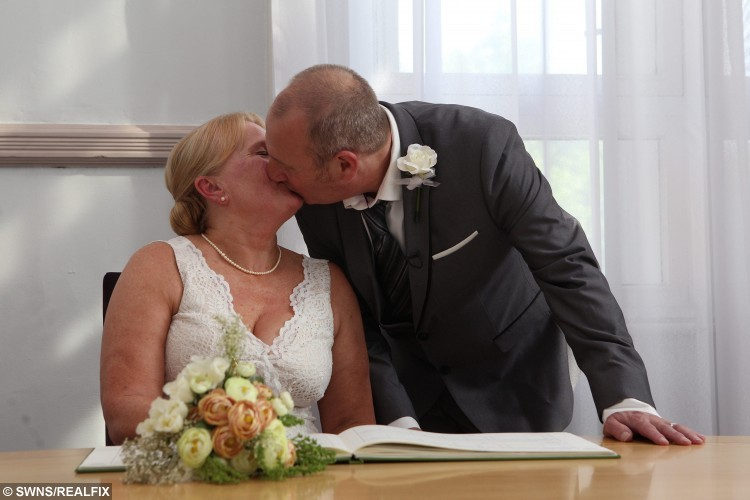 Bride and Groom Christine Sharlotte (nÃe Carroll) and Taffy Sharlotte, who suffers from a form of dementia, kiss after signing the register during their wedding ceremony, at Leeds Town Hall, in Leeds, West Yorkshire, on 15 September 2015. See Ross Parry Copy. RPYWED: Love-struck Christine Carroll has speedily arranged a wedding to her dementia-suffering soul-mate Taffy Sharlotte so that they can tie the knot while he still remembers her. The pair met just three years ago and thought they had the rest of their lives to share together until they received the bombshell that 62-year-old Taffy was suffering with a horrifying life debilitating form of dementia. Yesterday was a happy day as they married in a quiet ceremony with friends and family at Leeds Town Hall, West Yorks., but it was tinged with sadness as they know Taffy will deteriorate over time. Only the day before the wedding father-of-five Taffy was upset because he could not remember his name, and worried how he would be able to sign the register.