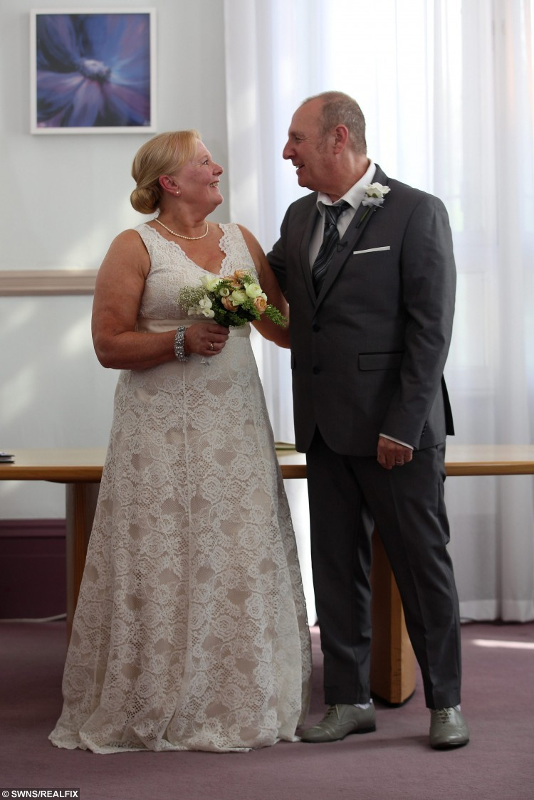 Bride and Groom Christine Sharlotte (nÃe Carroll) and Taffy Sharlotte, who suffers from a form of dementia, stand as man and wife for the first time, following their wedding ceremony, at Leeds Town Hall, in Leeds, West Yorkshire, on 15 September 2015. See Ross Parry Copy. RPYWED: Love-struck Christine Carroll has speedily arranged a wedding to her dementia-suffering soul-mate Taffy Sharlotte so that they can tie the knot while he still remembers her. The pair met just three years ago and thought they had the rest of their lives to share together until they received the bombshell that 62-year-old Taffy was suffering with a horrifying life debilitating form of dementia. Yesterday was a happy day as they married in a quiet ceremony with friends and family at Leeds Town Hall, West Yorks., but it was tinged with sadness as they know Taffy will deteriorate over time. Only the day before the wedding father-of-five Taffy was upset because he could not remember his name, and worried how he would be able to sign the register.