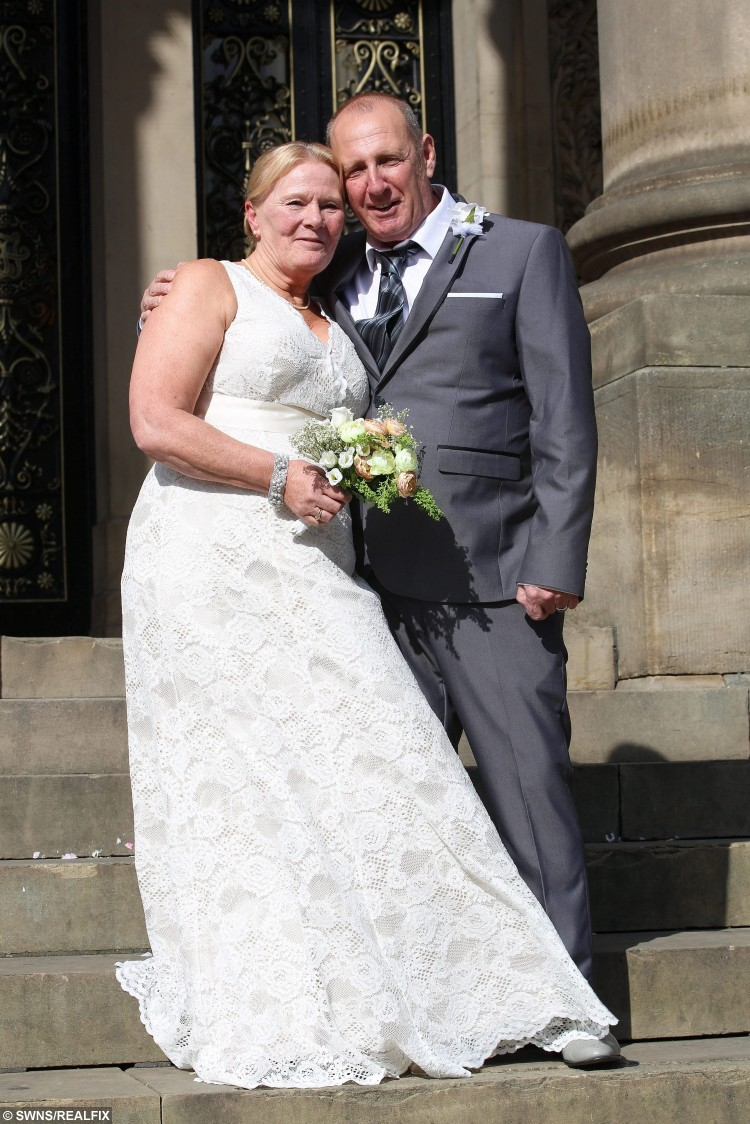 Bride and Groom Christine Sharlotte (nÃe Carroll) and Taffy Sharlotte, who suffers from a form of dementia, pictured moments after being married, on the steps of Leeds Town Hall, in Leeds, West Yorkshire, on 15 September 2015. See Ross Parry Copy. RPYWED: Love-struck Christine Carroll has speedily arranged a wedding to her dementia-suffering soul-mate Taffy Sharlotte so that they can tie the knot while he still remembers her. The pair met just three years ago and thought they had the rest of their lives to share together until they received the bombshell that 62-year-old Taffy was suffering with a horrifying life debilitating form of dementia. Yesterday was a happy day as they married in a quiet ceremony with friends and family at Leeds Town Hall, West Yorks., but it was tinged with sadness as they know Taffy will deteriorate over time. Only the day before the wedding father-of-five Taffy was upset because he could not remember his name, and worried how he would be able to sign the register.