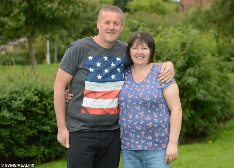 Gavin Preston with his wife Caroline Preston both from Walton Le Dale, Lancs., lost 6 stone so that he could sky dive out of a plane, 9 September 2015. See Ross Parry Copy RPYDIVE : A takeaway-gorging cabbie shed more than six stone so that he could throw himself out of a plane in honour of his late mum. Gavin Preston, 42, was told he was too fat to complete a charity skydive to raise money for the hospice where his beloved mother was cared for before she died of cancer. But not wanting to let her down, he turned his life around, and bravely took to the skies on Saturday.