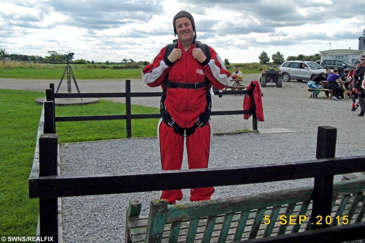 Gavin Preston from Walton Le Dale, Lancs., before his sky dive. Gavin lost 6 stone so that he could sky dive out of a plane, 9 September 2015. See Ross Parry Copy RPYDIVE : A takeaway-gorging cabbie shed more than six stone so that he could throw himself out of a plane in honour of his late mum. Gavin Preston, 42, was told he was too fat to complete a charity skydive to raise money for the hospice where his beloved mother was cared for before she died of cancer. But not wanting to let her down, he turned his life around, and bravely took to the skies on Saturday.