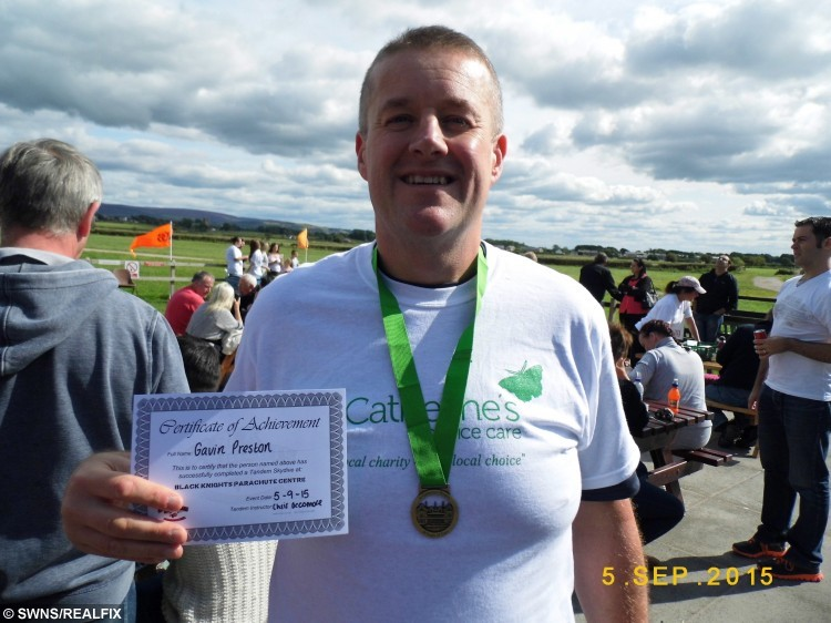 Gavin Preston from Walton Le Dale, Lancs., after his sky dive. Gavin lost 6 stone so that he could sky dive out of a plane, 9 September 2015. See Ross Parry Copy RPYDIVE : A takeaway-gorging cabbie shed more than six stone so that he could throw himself out of a plane in honour of his late mum. Gavin Preston, 42, was told he was too fat to complete a charity skydive to raise money for the hospice where his beloved mother was cared for before she died of cancer. But not wanting to let her down, he turned his life around, and bravely took to the skies on Saturday.