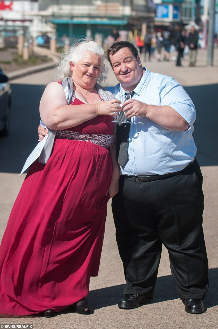 "Steven and Michelle Beer, who were on Channel 5 programme Too Fat to Work, renew their wedding vows at the Wedding Chapel on Blackpool Promenade. See Ross Parry copy RPYFAT : A couple branded ""too fat to work"" have celebrated losing weight by renewing their wedding vows - after the husband collapsed at his wedding reception. Steve Beer and wife Michelle were accused of being benefits slobs after appearing on a Channel 5 programme earlier in the year, telling how their weight prevented them from working. During the episode, Steve collapsed after he and Michelle tied the knot - and was later diagnosed with a life-threatening blood clot. The couple have since taken part in a boot camp to help them lose weight and have shed 20 stone between them."